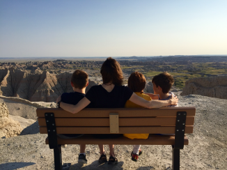 Aleta and the boys taking in the view in the Badlands National Park, Conata, United States.