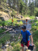 Aleta and the boys doing a creek crossing.